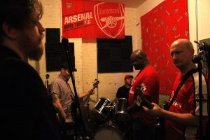 """Punk-rock band, Guns Don't Run, practice in Brooklyn on Nov.29, 2015. From left to right - Austin WIlliams (Insurance), Justin Miran (Finance), Daniel Jaryniewichor (Food Industry), Ron Treasure (Insurance), Henry (Jamie) Behar (Gynaecology). """"We're friends. This is our hobby, our card game. We do everything we love, drinking and watching football (soccer),"""" Mirans says about Guns Don't Run."""