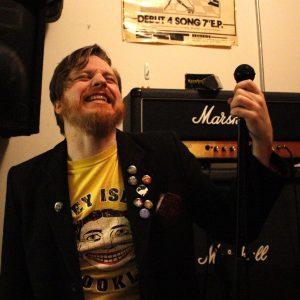"Austin Williams, guitarist at Guns Don't Run taking a break from rehearsal in Brooklyn on Nov. 29. ""Austin is like our little ounk fashionista,"" says Miran, bassist."