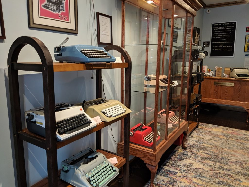 Refurbished typewriters line the shelves of Gramercy Typewriter Company.