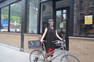 East Village biker dons a helmet before riding.