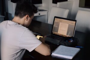 young-man-using-mobile-phone-while-studying-online-classes-e-learning-remote-classes-distant_t20_jXYdOk