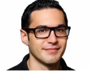 Picture of Eric Kohn -- a white man with rectangular-framed glasses -- above IndieWire's logo